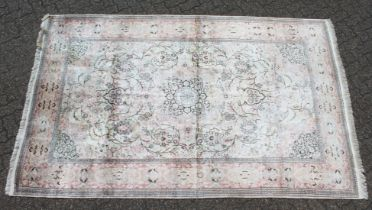 A MID 20TH CENTURY PERSIAN SILK KASHMIR CARPET, pale cream ground with typical floral decoration.