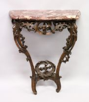 AN 18TH /19TH ITALIAN ROUGE MARBLE AND CARVED OAK CONSOLE TABLE, of serpentine outline, the top
