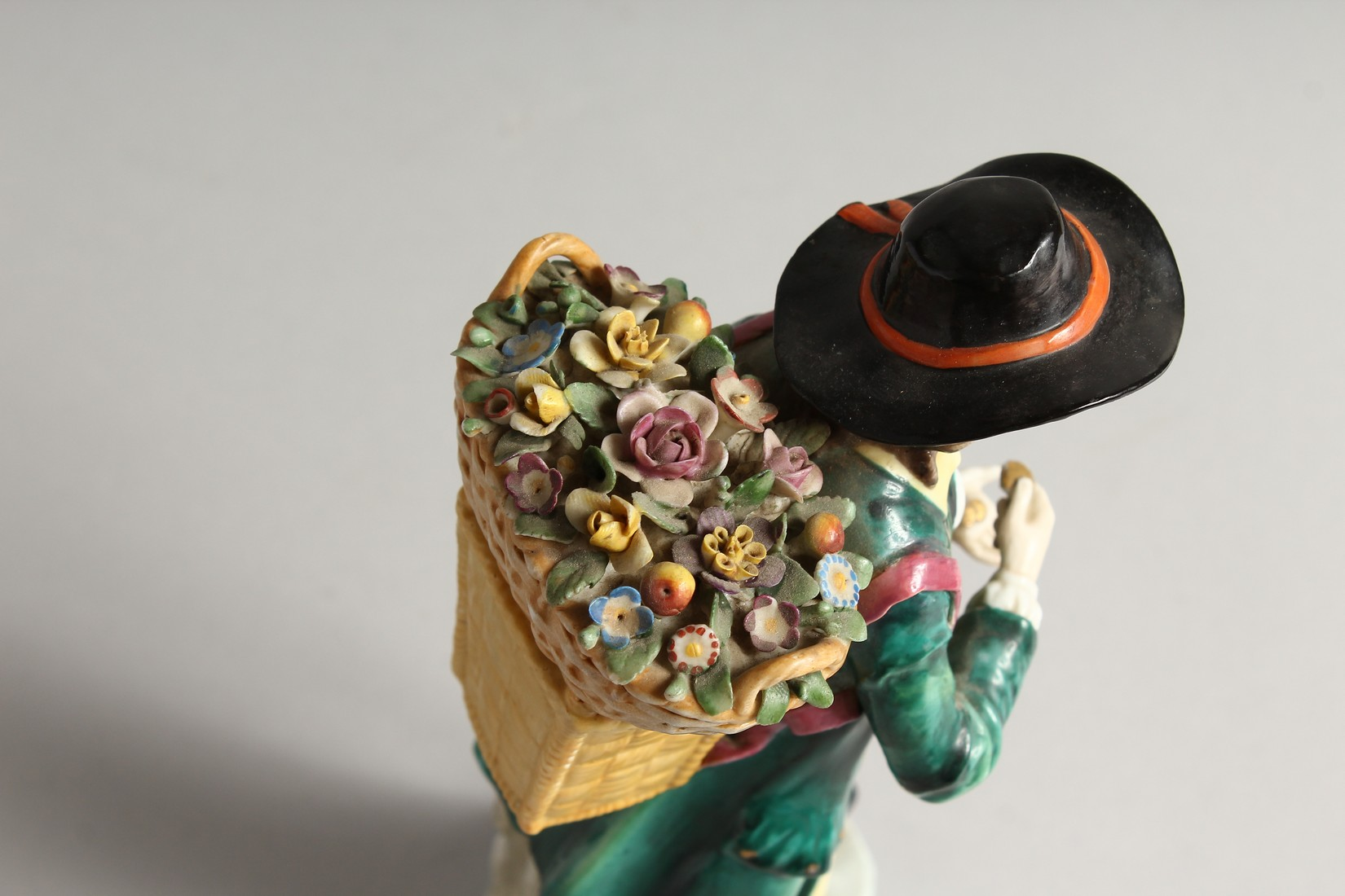 A SAMSON CHELSEA DERRY PORCELAIN FIGURE of a man, a basket of flowers on his back 9ins high. - Image 5 of 6
