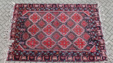 A LARGE PERSIAN CARPET with twenty main medallions 10ft long x 6ft 6ins wide.