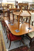 A GOOD GEORGE III DESIGN MAHOGANY TWIN PILLAR DINING TABLE with loose leaf. 7ft 9ins long 3ft wide.