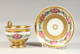 A LARGE PARIS PORCELAIN CUP AND SAUCER, with gilt and floral bands.