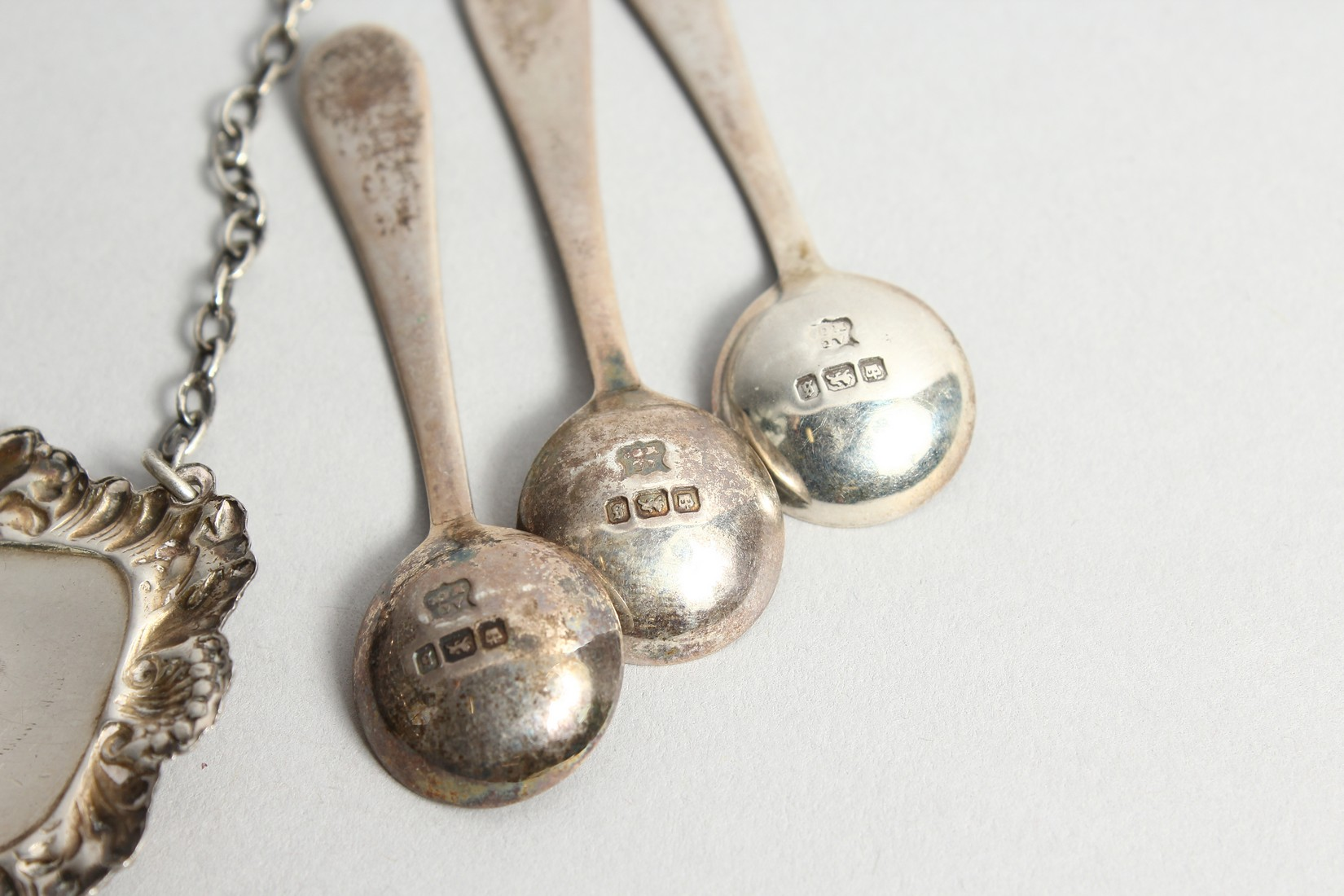 A SILVER BRANDY LABEL AND THREE SALT SPOONS - Image 4 of 4