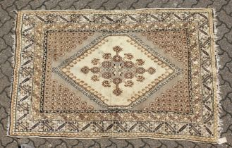 A PERSIAN RUG brown and cream with large medallions. 6ft 6ins long x 4ft 6ins wide.