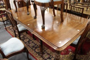 A GOOD VICTORIAN MAHOGANY EXTENDING DINING TABLE with 2 leaves on turned legs with castors. 9ft 8