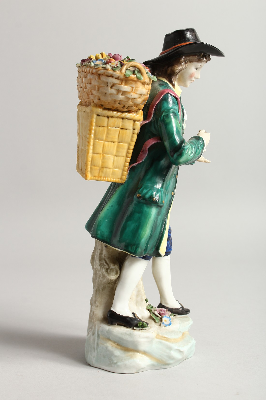 A SAMSON CHELSEA DERRY PORCELAIN FIGURE of a man, a basket of flowers on his back 9ins high. - Image 4 of 6