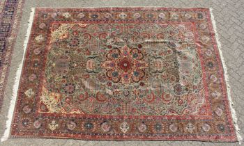 A LARGE PERSIAN TABRIZ CARPET, pale green ground with all over stylised floral decoration within a
