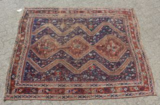 AN EARLY 20TH CENTURY KHAMESH RUG, dark blue ground with three central diamond shaped motifs. 6ft