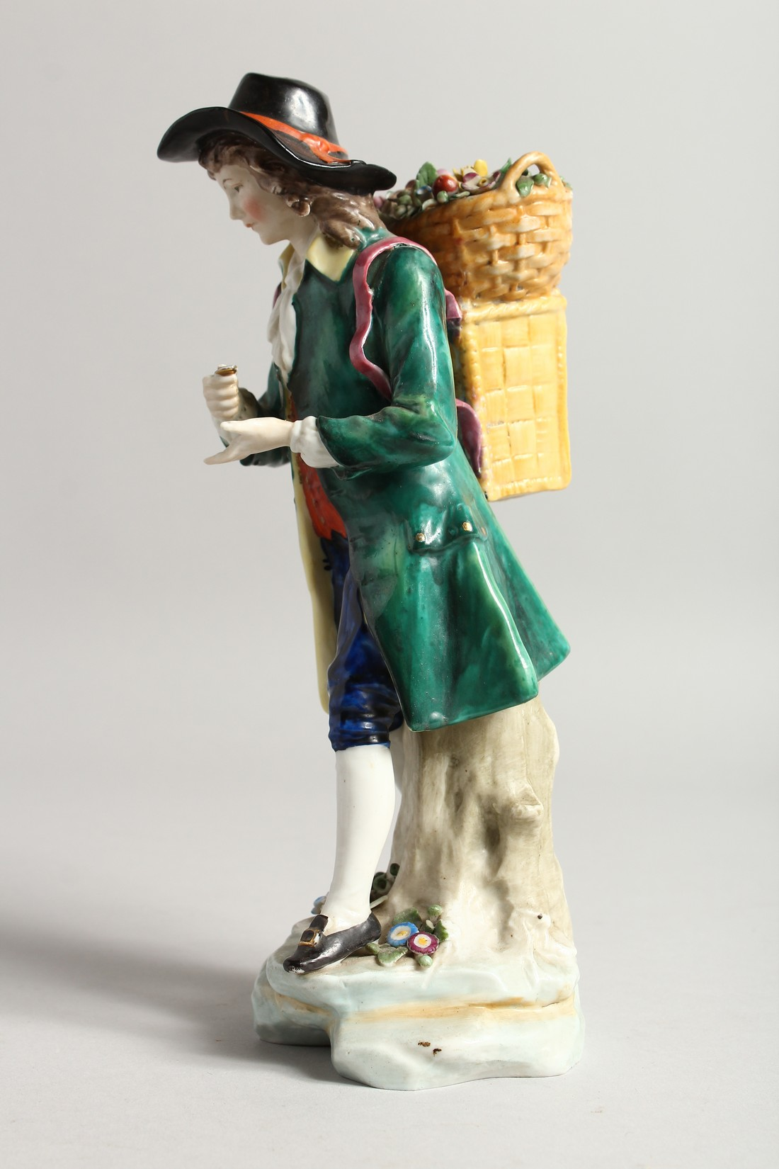 A SAMSON CHELSEA DERRY PORCELAIN FIGURE of a man, a basket of flowers on his back 9ins high. - Image 2 of 6