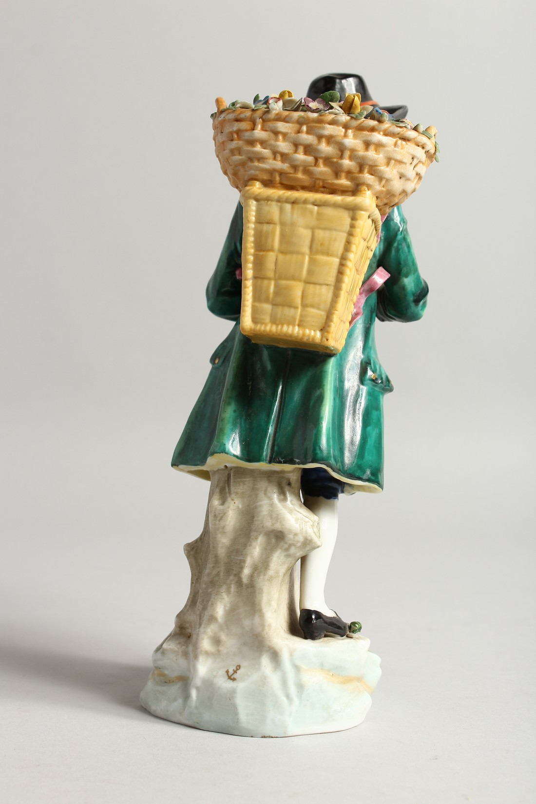 A SAMSON CHELSEA DERRY PORCELAIN FIGURE of a man, a basket of flowers on his back 9ins high. - Image 3 of 6