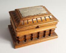 AN OAK CASKET with a silver plaque, OTTO VON BISMARCK, and paper label, ST AATLICHES MUSEUM. 9ins