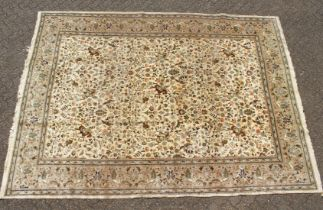 A LARGE PERSIAN HUNTING CARPET, cream ground with an all over hunting scene. 12ft 2ins long x 9ft