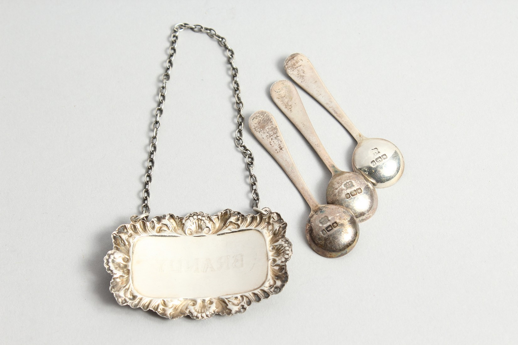 A SILVER BRANDY LABEL AND THREE SALT SPOONS - Image 3 of 4