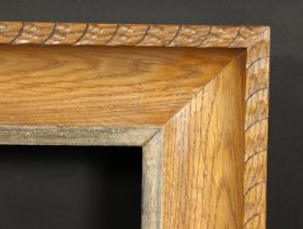 A carved oak frame with silvered inner ornaments, rebate size 24 x 36 , 61cm x 92cm.