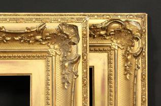 A pair of 19th century gilt composition swept frames, rebate size each 10 x 20 , 25.5cm x 51cm.
