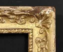 An early gilt composition frame with moulded inner ornament, wide rebate 16 x 13 , 40.5cm x 33cm.