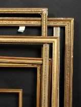 A group of eight moulded and composition frames of various designs, sizes from 21.5 x 29.5 to 10 x
