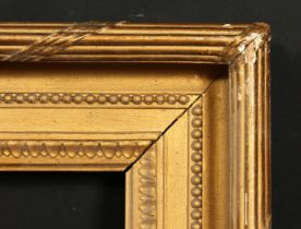 A 19th century gilt composition frame with moulded and ribbon tied top ornament, rebate size 13 x