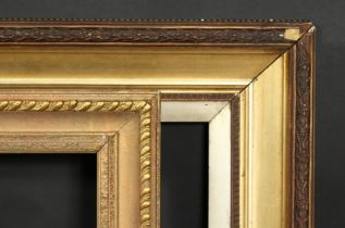A 19th century gilt composition frame, rebate size 24 x 36 , 61cm x 91.5cm along with a 20th century