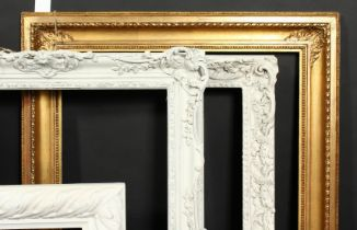 A group of four early 20th century frames of various styles, rebate size 12.75 x 19 , 32cm x 48cm,