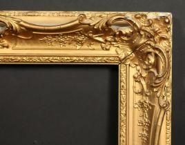 A 19th century gilt composition swept frame, rebate size 22.5 x 35.5 , 57cm x 90cm.