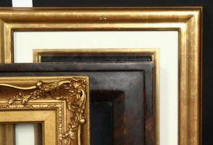 A group of three 20th century frames, rebate sizes 6.5 x 8 , 16.5xm x 20cm, 8.5 x 11.5 , 21.5cm x