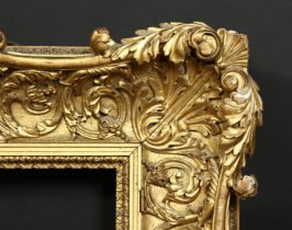 A 19th century carved wood frame with locking inner front ornament, rebate size 12 x 16 , 31cm x