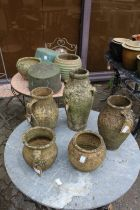 Terracotta and stoneware pots and two old copper saucepans.