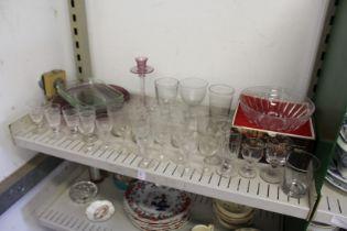 A shelf of glassware.