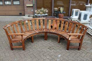 A two part semi-circular hardwood garden bench.