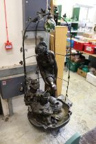 A large bronze effect figural water feature.