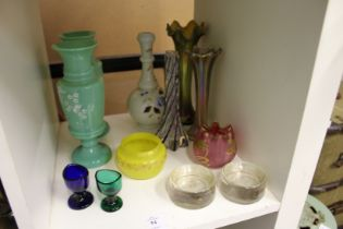 A small group of colourful glassware.