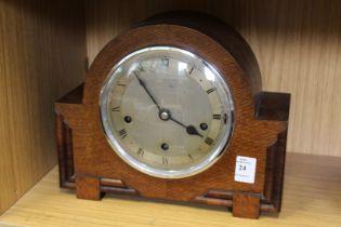 An oak mantle clock.