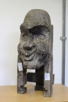 A carved wood bust.