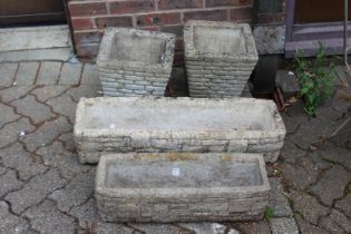 A pair reconstituted stone garden planters and two similar garden troughs.