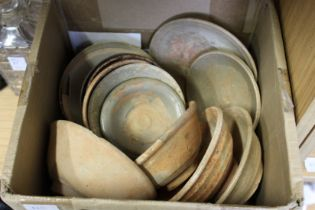 A quantity of old Chinese terracotta bowls.