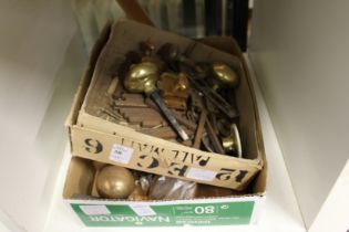 Two boxes of brass and other door furniture.