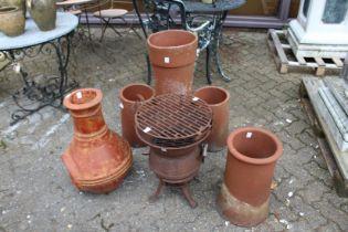 A chimenea, terracotta chimney pots and cast iron stove.