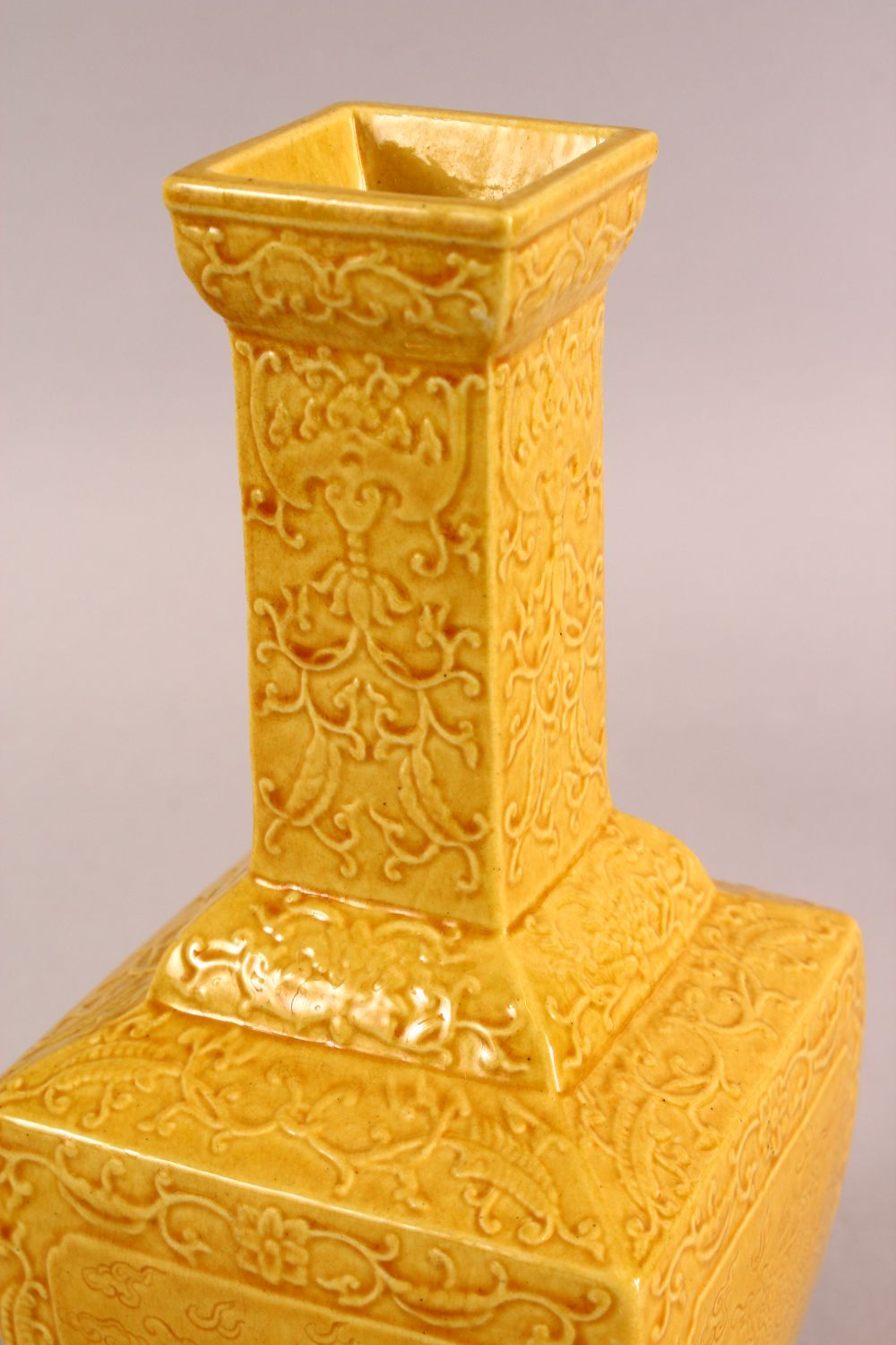 A SMALL CHINESE YELLOW GROUND SQUARE FORM VASE, with relief decoration of bats and stylised flora, - Image 4 of 6
