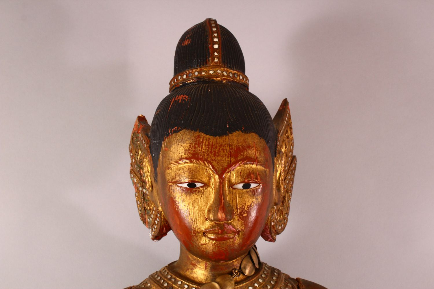 A LARGE THAI GILT AND RED LACQUER CARVED WOOD FIGURE, standing on a lotus base, 104cm high. - Image 2 of 8