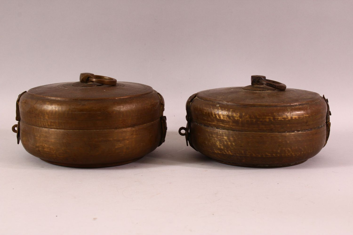 A PAIR OF INDIAN SPICE BOXES, both with hinged lid and handle to top, both approx. 21cm diameter. - Image 2 of 6