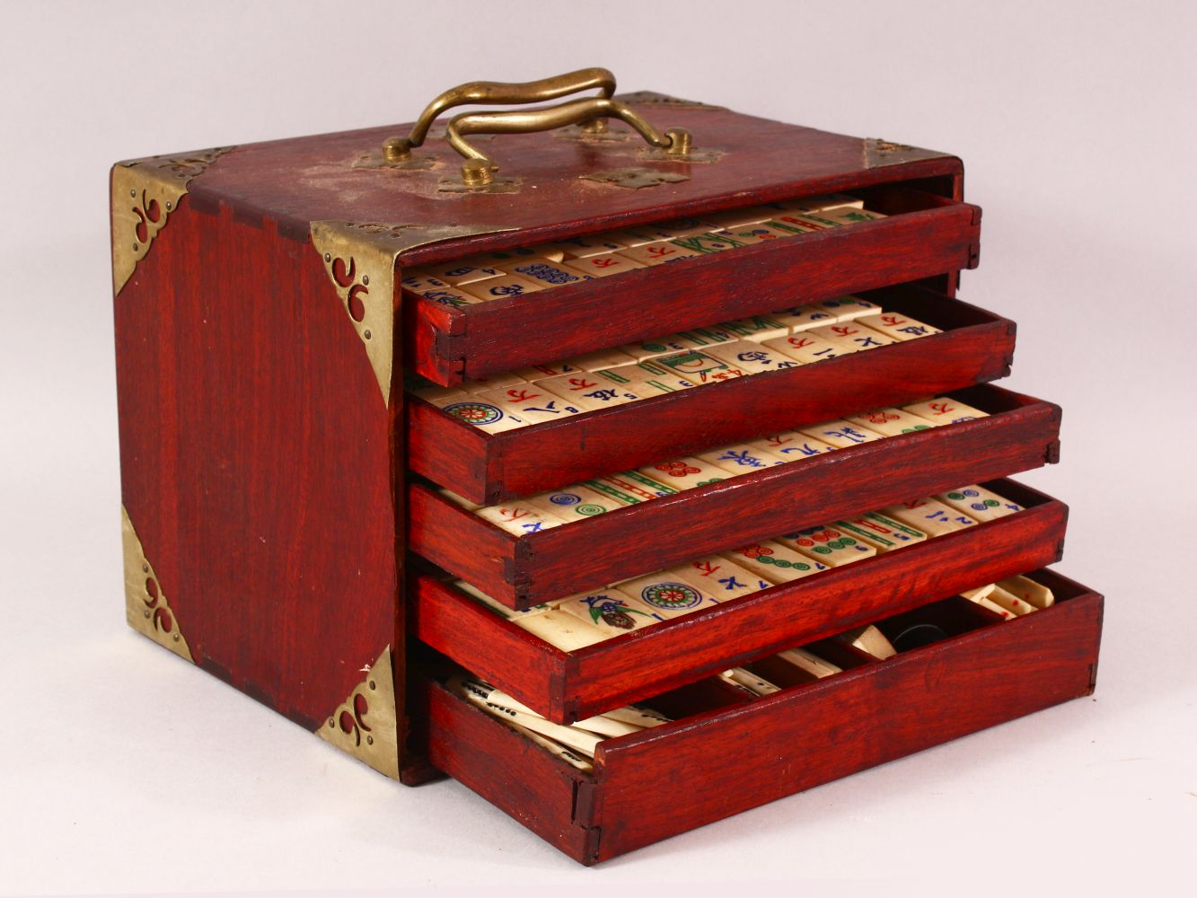 A CHINESE BAMBOO & BONE BOXED MAHJONG SET - comprising 56 drawers full of counters and sticks,