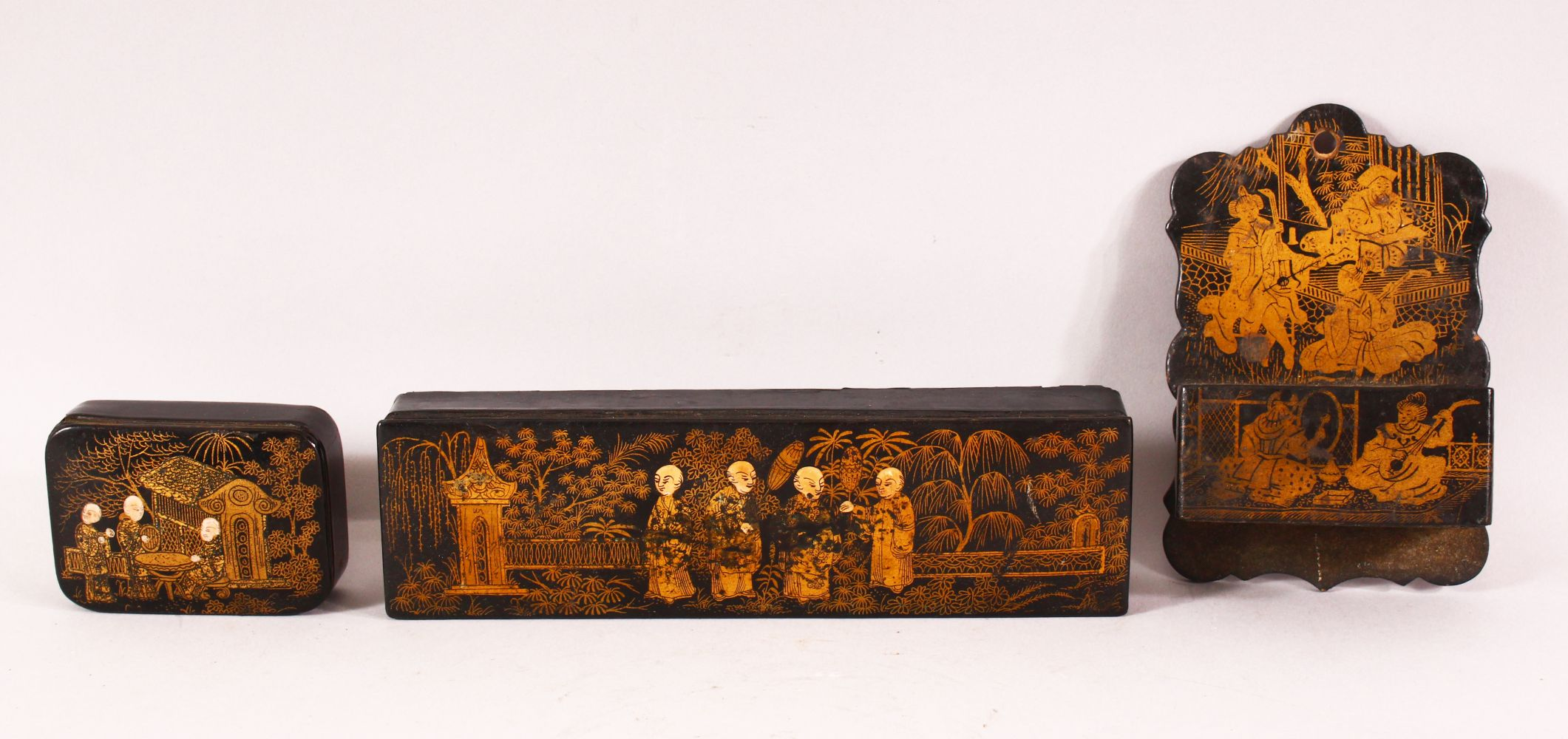 THREE CHINESE GILT LACQUER PIECES, comprising of one pen box, one smaller box and one match box/