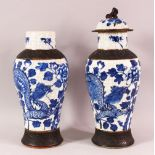 TWO 19TH CENTURY CHINESE BLUE & WHITE PORCELAIN VASES & ONE COVER, the body of the vases decorated