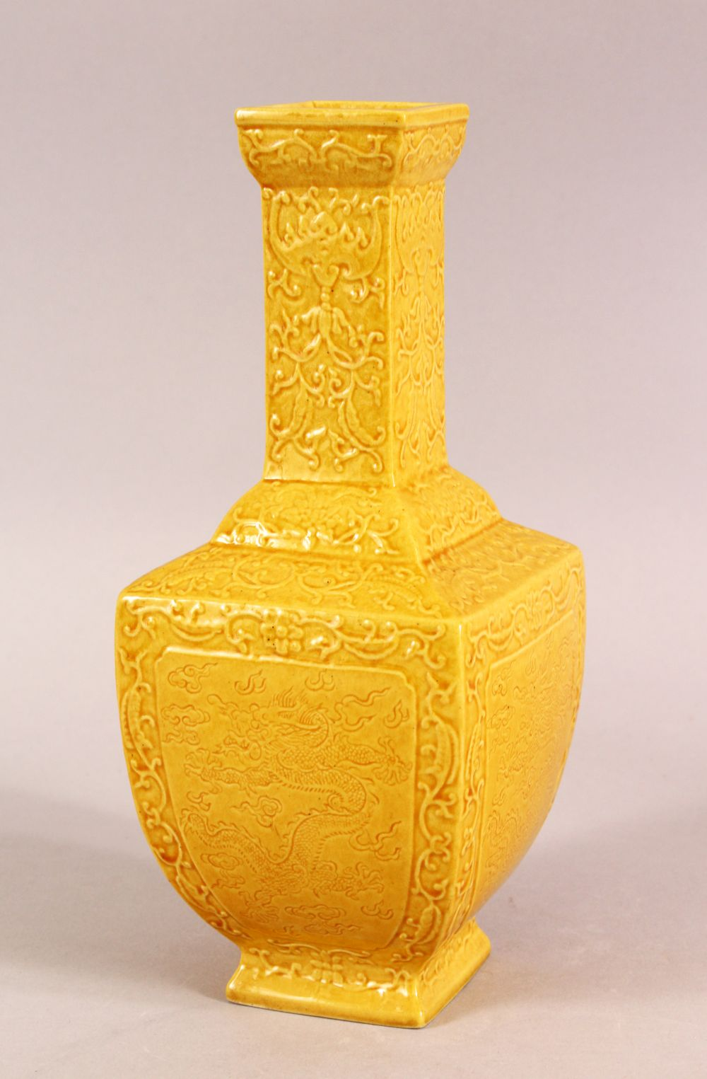 A SMALL CHINESE YELLOW GROUND SQUARE FORM VASE, with relief decoration of bats and stylised flora,