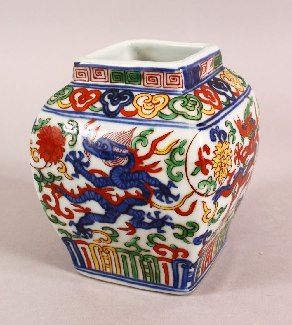 A SMALL CHINESE WUCAI STYLE VASE, the body painted with dragons and flowers, six character mark to