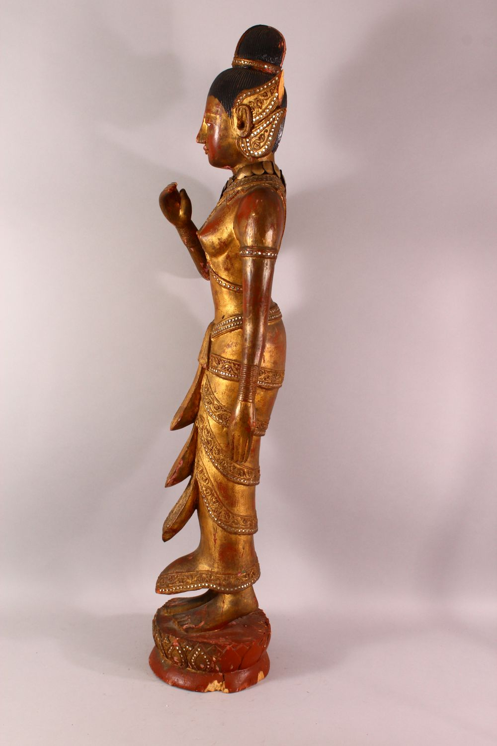 A LARGE THAI GILT AND RED LACQUER CARVED WOOD FIGURE, standing on a lotus base, 104cm high. - Image 7 of 8
