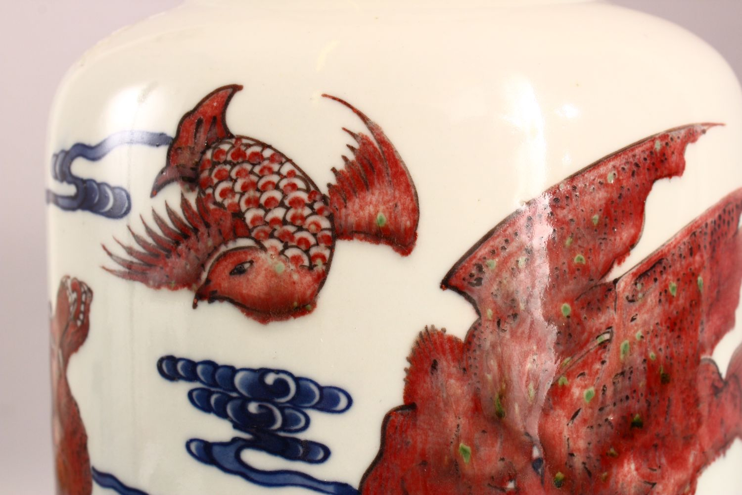 A CHINESE IRON RED, BLUE AND WHITE VASE, the body painted with mythical creatures amongst stylised - Image 6 of 7