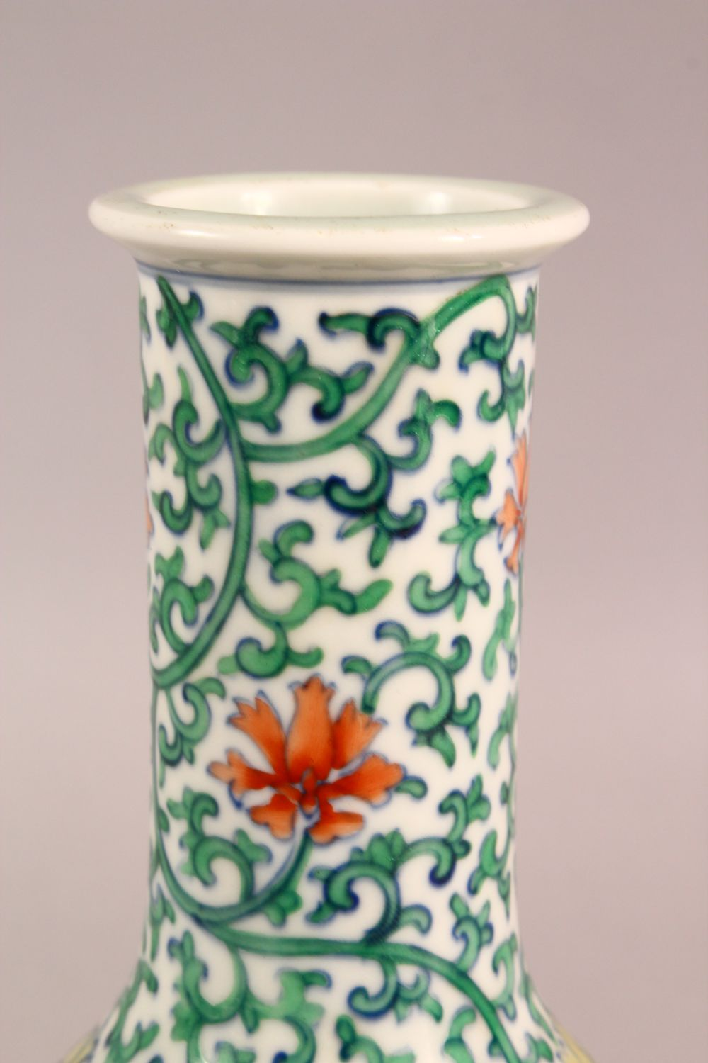 A SMALL CHINESE FAMILLE VERTE PORCELAIN VASE, profusely painted with flowers and vines, six - Image 3 of 6