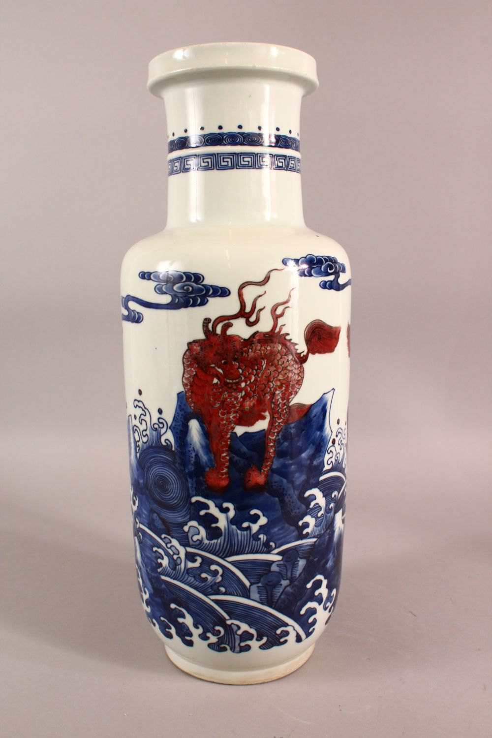 A CHINESE IRON RED, BLUE AND WHITE VASE, the body painted with mythical creatures amongst stylised - Image 3 of 7